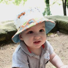 ce4cc827 Items similar to Boy's sun hat, bucket style with brim, reversible, cute  cotton prints, bicycles and blue on Etsy