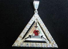 Sterling silver  triangel pendant with white zircons and red zircon. www.myfashionjewellry.com www.myjewellry.weebly.com e-mail: mavistar07@gmail.com