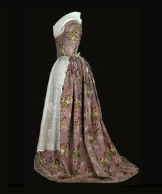 1760-1770, remodeled ca. 1785; France; Silk brocaded with silk, trimmed with silk fringe, bodice lined with linen, reproduction kerchief and...