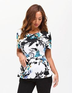 The Peplum Top in Garden Party is a contemporary addition to women's medical scrub outfits. ShopJaanuufor scrubs, lab coats and other medical apparel.