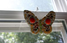 Bright, beautiful, colorful mosaic butterfly.  I took a lightweight board made for mosaics called Wediboard and hand cut it into the shape of a butterfly.  This sweet thing measures 3-1/2 inches by 4 inches and is covered in glass tiles, glass 1/2 circles and hand cut vintage broken china.  ...