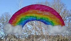 Rainbow Sun Catcher made from coffee filter. Colour rainbow with washable markers then brush with glue, let dry, peel away from wax paper and add cotton ball clouds if you wish.