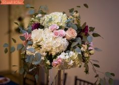 Head table floral arrangement in light pink, white and burgundy for wedding reception in High Point, NC. By Eliana Nunes Floral Design