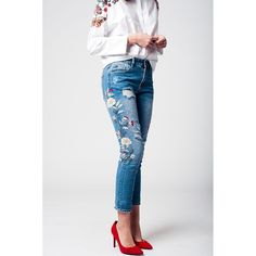 559102e2d219 Mid wash low waist denim trousers with red and beige floral embroideries.  Has slight tears in the front and on the back pockets. 5 functional pockets.