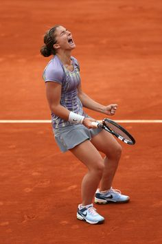 PARIS, FRANCE - JUNE 02: Sara Errani of Italy celebrates match point in her Womens Singles match against Carla Suarez Navarro of Spain during day eight of the French Open at Roland Garros on June 2, 2013 in Paris, France. (Photo by Clive Brunskill/Getty Images)
