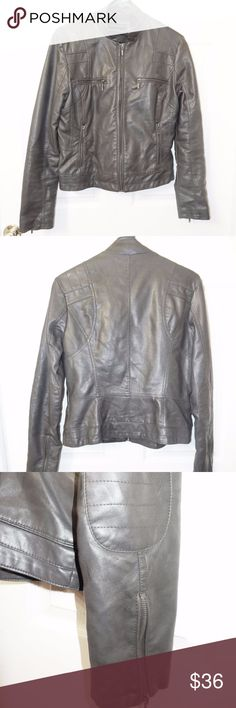 Nordstrom Bernardo Faux Leather Moto Jacket Edgy motorcycle zippered jacket -- perfect for fall. It does have a small tear on the back above the elbow detail as well as pen mark so I'm selling this with a deep discount. Four zippered pockets & double snap closure on collar. Sleeves also unzip to just below the elbow. 100% polyurethane  exterior and interior is 50% viscose/50% polyester Bernardo Jackets & Coats