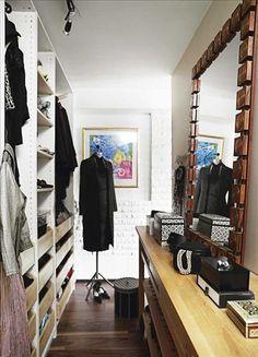 fake wall makes a walk in closet