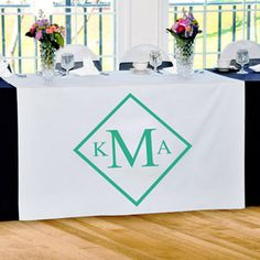 WeddingDepot.com ~ Personalized Table Runner - Diamond Monogram ~ Creating an ideal focal point to every wedding reception table it decorates, our Diamond Monogram Table Runner is fashioned in crisp white polyester and accented with a diamond encircled monogram and color of your choosing.