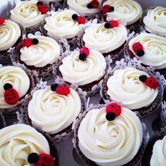 Ladybug cupcakes on red velvet