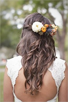 Add a beautiful floral headpiece that matches your bridal bouquet and secure it to this half-up, half-down wavy hairdo with the top section pulled together with a   braid. | 20 Long #Wedding #Hairstyles 2013 | Confetti Daydreams |
