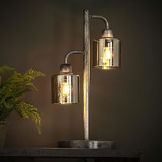 This industrial table lamp has two light sources, is made of metal and has a yellow-tinted glass cap. The light sources distributes the light in a beautiful way through the room, creating a great ambiance. Drop Lights, Wall Lights, Ceiling Lights, Hudson Table, Apartment Lighting, Industrial Table, Mason Jar Lamp, Beautiful Lights, Sconces