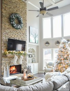 stacked-stone-christmas-fireplace-in-two-story-great-room-with-coffered-ceiling