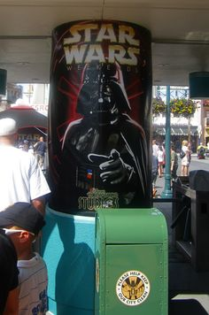A poster of Darth Vader looms over the turnstyles at Disney's Hollywood Studios' Star Wars Weekends