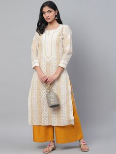 Ada Hand Embroidered Fawn Cotton Lucknow Chikan Kurti-A230802 offers a comfortable and relaxed silhouette to the wearer. #Adachikan #chikankari #handembroidery #chikan #cotton