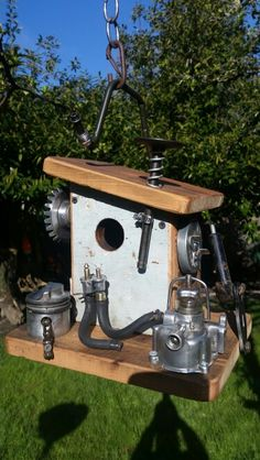 old outboard parts birdhouse