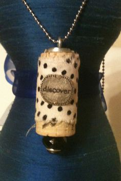 Upcycled Wine Cork Pendant: Discover. Like word and fabric wrap. Idea photo only.