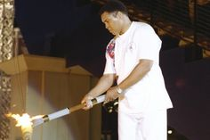 This Day In Olympic History: July 19, 1996 - Former U.S. boxing gold medalist Muhammad Ali, his body beset with Parkinson's syndrome, lit the Olympic flame at the opening ceremony of the Summer Olympics in Atlanta.  keepinitrealsports.tumblr.com  keepinitrealsports.wordpress.com  facebook.com/pages/KeepinitRealSports/250933458354216  Mobile- m.keepinitrealsports.com