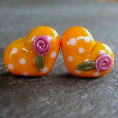 Lampwork beads 1154 Hearts Pair (2) Coral with Polka Dots and Pink Roses, via Etsy.