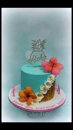 Hawain themed birthday cake with handmade franapani and hibiscus flowers so much fun making this one x