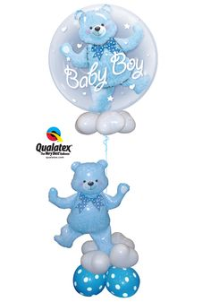This unique balloon delivery features a Qualatex Double Bubble Balloon and a coordinating cut-out in the base. Just change out the balloons for a baby girl.