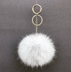 GRAY FUR POM POM #gray #silver #black #pink #gold #keychain #shoulderbags #bag #leatherbag #handmade #handmadejewelry #accessories #accessory #woman #women #worldwide #summertime #sun #hot #trendy #style #etsy #seller  #makeup #magazine #jewelry #new #love #flamingo #damiankastorianfurs