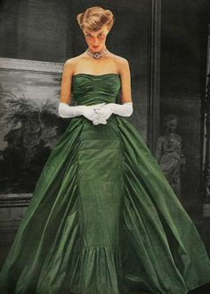 Jean Patchett wearing a gorgeous green silk taffeta ball gown by Adrian. Photographed by John Rawlings for Vogue November 1948.