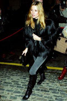Kate Moss in skinny jeans, rocker boots + a statement fur coat