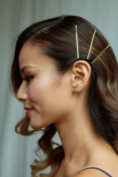 """""""I went with retro hollywood glam curls but added some safety pins to give it a modern twist."""""""
