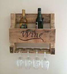 Pallet wood wine rack with wood burned word WINE. Size: x Custom sizes are available. If custom size and glass holders are desired, please leave details in the comment box. Unique Wine Racks, Rustic Wine Racks, Diy Wine Racks, Farmhouse Wine Racks, Diy Pallet Projects, Wood Projects, Pallet Wine Rack Diy, Wine Rack From Pallets, Pallet Wine Holders