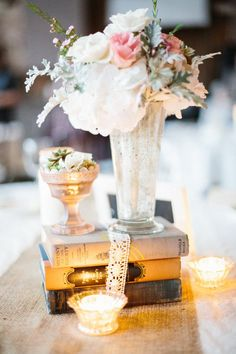 vintage centerpieces with a mix of mercury glass, candles and vintage books  Photography By / valophotography.com, Flowers By / bloom-laurelflan.com