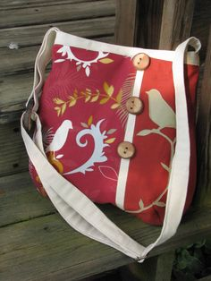 Bird Enchantment shoulder bag in rust and off white with adjustable strap and 6 pockets