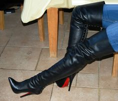 Thigh boots and jeans