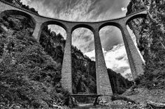 the Landwasser viaduct. This is a famous landmark on the Rhaetian Railway, a high curved structure leading directly into a tunnel through a cliff face (seen in the top right of my shot).