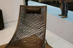 This lounge chair is from Italian brand MatteoGrassi. Part of the Loom collection, the laser cut leather is the basis of various side chairs, sculptural forms and room dividers.