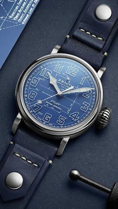 """Limited to 250 pieces, the Pilot Type 20 Blueprint remains true to the legacy of Zenith's ubiquitous Pilot watch. The oversized steel case, finished with a mix of polished and satin-brushed surfaces, features the signature oversized """"onion"""" shaped crown that allows the time to be adjusted even while wearing flight gloves. The side of the case features a screwed plaque bearing the unique limited edition number of the watch. #limitededition #zenithwatch #Menswatch #wristwatch #blueprint Limited Edition Watches, Luxury Watches, Watches For Men, Pilot, Jewelry Design, Jewels, Band, Type, Leather"""