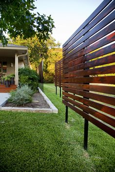 Due to restrictions, we were not able to add a privacy fence.  Our solution was some free standing panels that screen the view and add interest to the back and side yard.