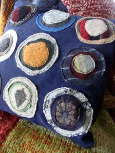 Felted wool from recycled sweaters make a colorful addition to denim pillows.
