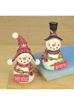Your home will be festive and bright with this Ohio State Buckeyes Snowman Fans Decor. Rally House has a great selection of new and exclusive Ohio State Buckeyes t-shirts, hats, gifts and apparel, in-store and online. Ohio State Buckeyes, Ohio State Wreath, Nike Ohio State, Ohio Football, American Football, Ohio State Colors, Buckeye Crafts, Dorm Decorations, Christmas Decorations
