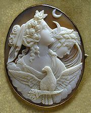 Cameo in the high Romantic style, depicting an allegory of Night and Day, with a dove in the foreground bearing a cornucopia representing the coming of morning. Night wears a crown of opium poppies. Mocha and milk colors