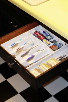If I ever have a bathroom cabinet with a shallow drawer - I will do this!