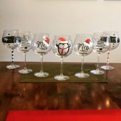 Hand painted wine glasses for Christmas. DecoColor Opaque Paint Markers and Martha Stuart Acrylic Craft Paint.