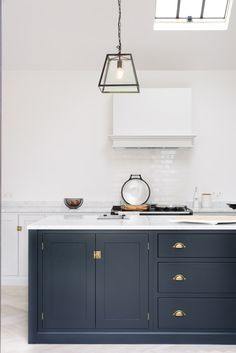 Bella Brass handles paired with our Pantry Blue Shaker cupboards; a classic look that is sure to stand the test of time.