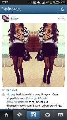 Black and white long sleeve with all black high waisted skirt black tights high ankle boots
