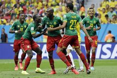 Cameroon's Joel Matip, second right, celebrates scoring his side's first goal during the group A World Cup soccer match between Cameroon and Brazil at the Estadio Nacional in Brasilia, Brazil, Monday, June 23, 2014.