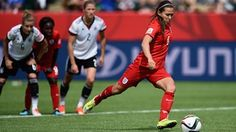 Fara Williams of England scores the opening goal from a penalty