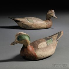 "Sold for: $ 132,000 Pair of Rare Ward Brothers Widgeon Decoys, Lemuel T. Ward (1896-1983) and Stephen Ward (1895-1976), Crisfield, Maryland, early 20th century, turned-head figures with original paint, (minor losses, repairs), lg. 15 1/2 in.   Provenance: Former William (Bill) F. Mackey, Jr., collection, the decoys bear the ""Mackey Collection"" stamp on bases.   Literature: The drake of this pair is illustrated in William F. Mackey, Jr., American Bird Decoys (New York: Bonanza Books, 1965), p. 1"
