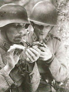 Allied and Axis troops momentary cease fire to enjoy pipes.