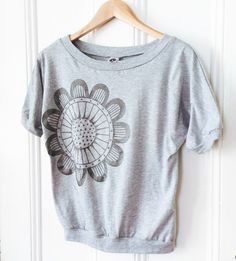 Hand-drawn bloom printed onto a soft, lightweight scoop-neck dolman t-shirt. There's a sparkle to the ink that's quite fun! ;)
