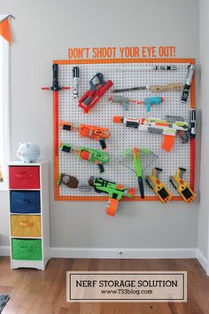Nerf gun organization from 733 Blog - I love any type of creative toy organization and this is super cute for the basement!