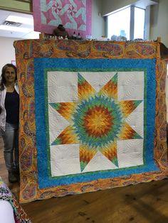Used longarm to quilt this #batik #star.  #QuiltSmart pattern 58 inch #Lone Star. I added #KaffeeFasstt borders